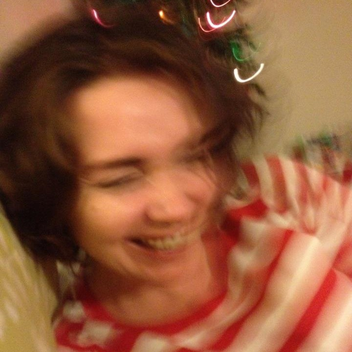 Blurred image of the author laughing very hard.